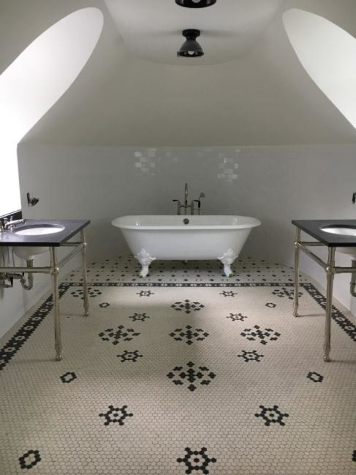 Photo -  Blue and white mosaic tiles create different zones in this attic bath by Allison Tick. [ALLISON TICK]