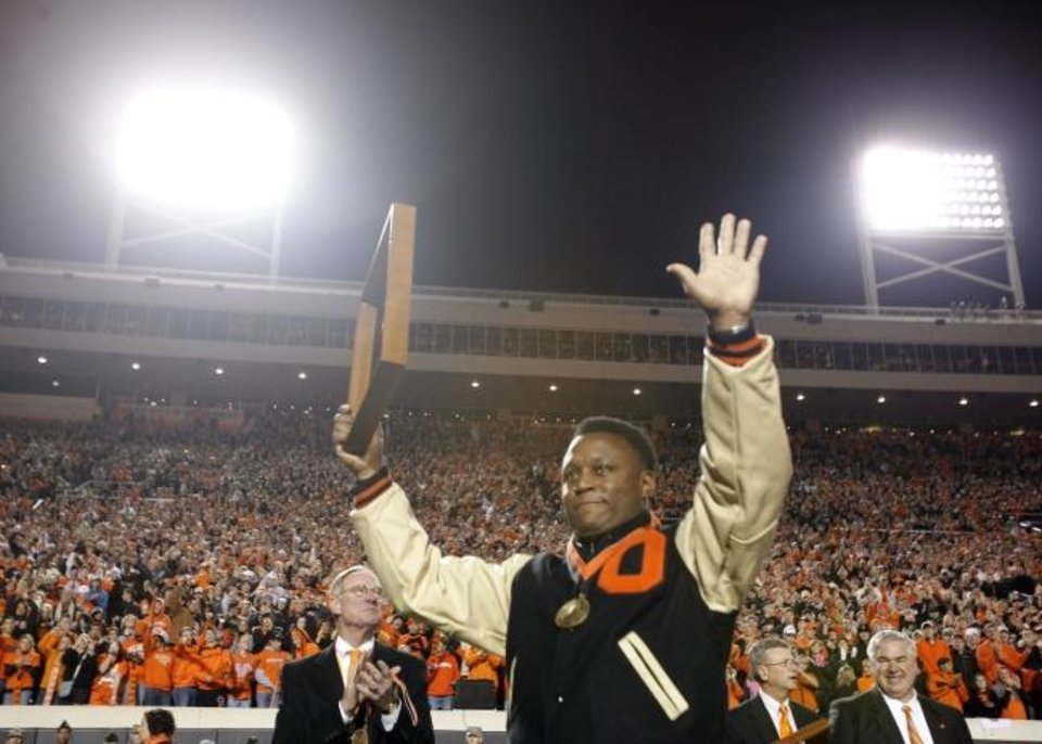 Photo -  Barry Sanders waves to the crowd at Boone Pickens Stadium during a 2009 OSU game against Missouri. [Sarah Phipps/The Oklahoman]