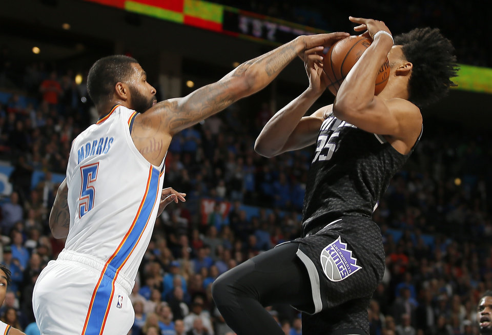 Photo - Oklahoma City's Markieff Morris (5) defends Sacramento's Marvin Bagley III (35) during an NBA basketball game between the Oklahoma City Thunder and the Sacramento Kings at Chesapeake Energy Arena in Oklahoma City, Saturday, Feb. 23, 2019. Sacramento won 119-116. Photo by Bryan Terry, The Oklahoman