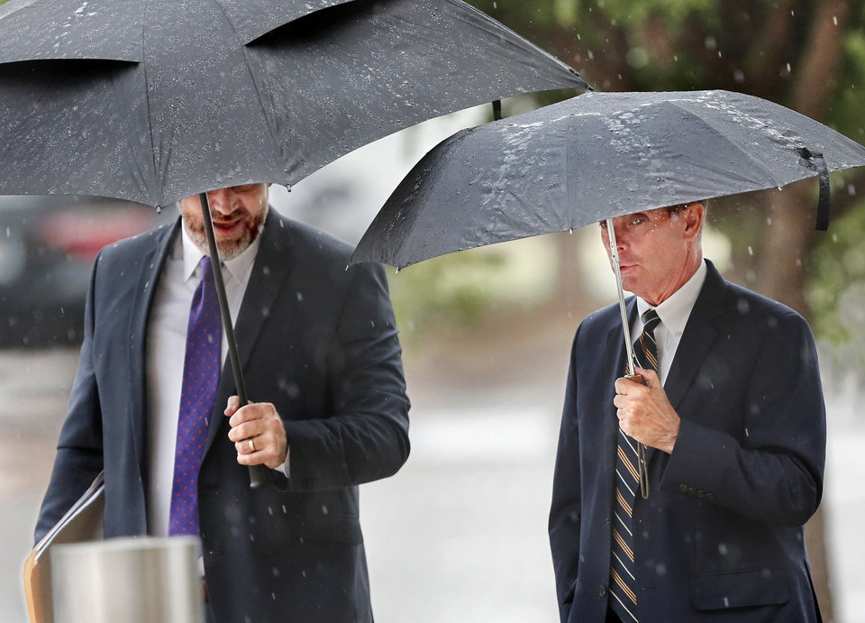 Photo -  Former Oklahoma Health Commissioner Terry Cline, right, arrives Tuesday to meet with the Oklahoma multicounty grand jury. He is accompanied by his attorney, Gary Wood. [Photo by Jim Beckel, The Oklahoman]