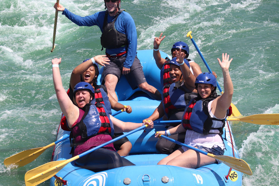 Photo -  A group of rafters celebrate their trip through white water at Riversport OKC. [Provided by Riversport OKC]