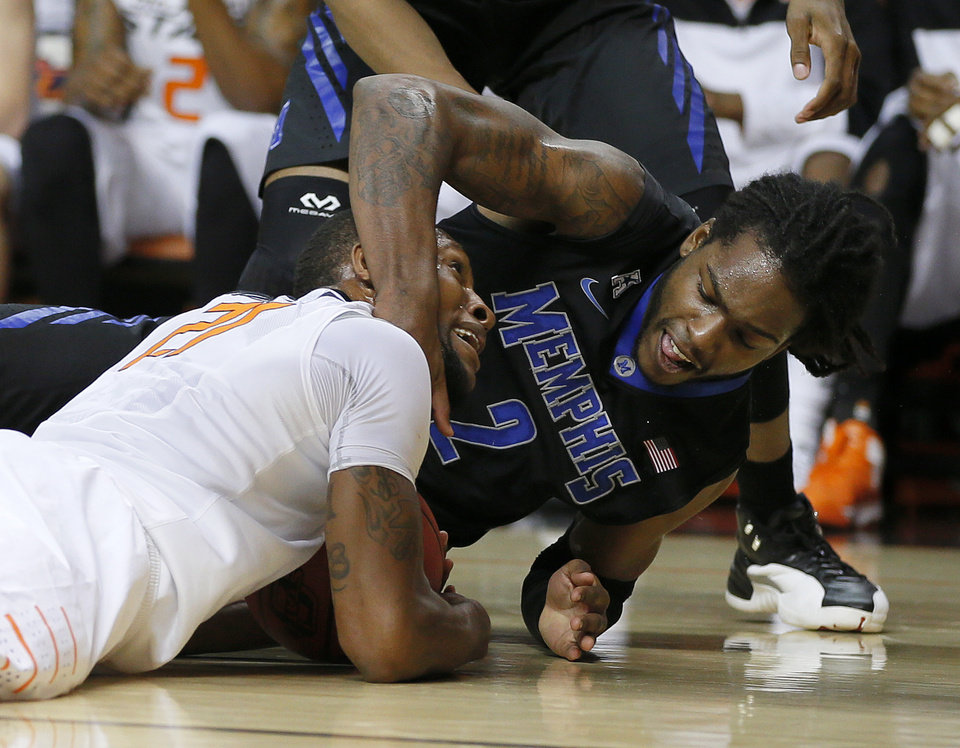 Photo - Oklahoma State's Kamari Murphy (21) and Memphis' Shaq Goodwin (2) fight for a lose ball during an NCAA college basketball game between Oklahoma State and Memphis at Gallagher-Iba Arena in Stillwater, Okla., Tuesday, Nov. 19, 2013. Photo by Bryan Terry, The Oklahoman