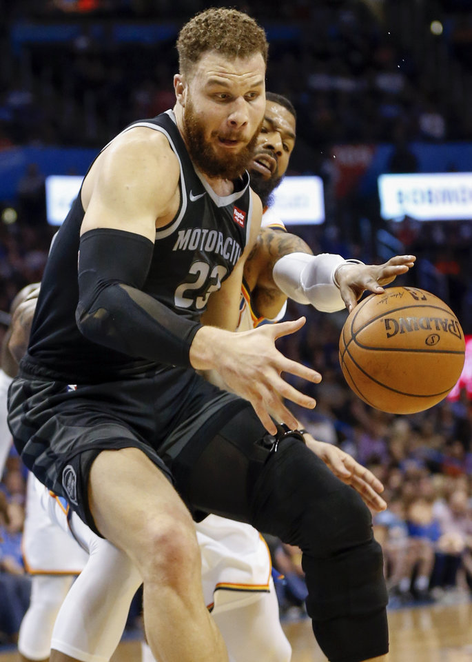 Photo - Oklahoma City's Markieff Morris (5), back right, tries to steal the ball from Detroit's Blake Griffin (23) in the fourth quarter during an NBA basketball game between the Detroit Pistons and the Oklahoma City Thunder at Chesapeake Energy Arena in Oklahoma City, Friday, April 5, 2019. Oklahoma City won 123-110. Photo by Nate Billings, The Oklahoman