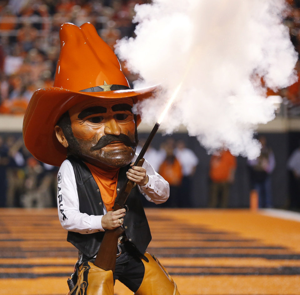 Photo - OSU mascot Pistol Pete fires a shotgun during the Bedlam college football game between the Oklahoma State Cowboys (OSU) and the Oklahoma Sooners (OU) at Boone Pickens Stadium in Stillwater, Okla., Saturday, Nov. 4, 2017. OU won 62-52. Photo by Nate Billings, The Oklahoman