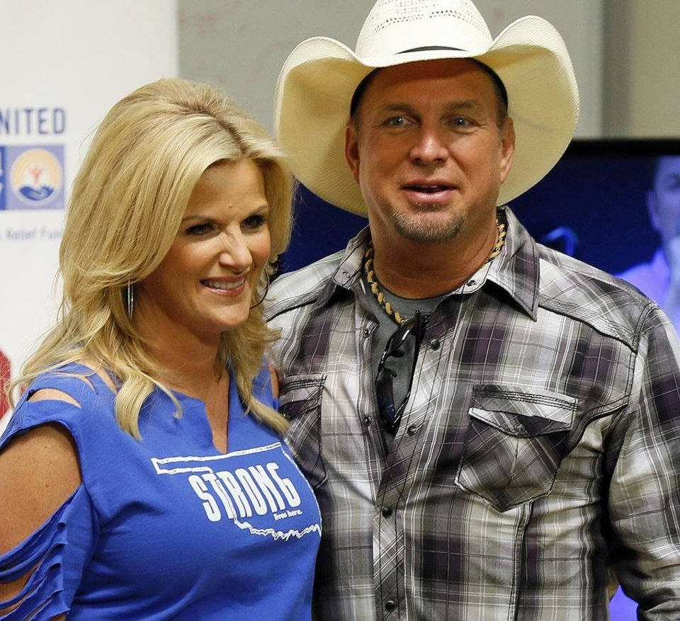 Photo - Trisha Yearwood and Garth Brooks talk to the media during the Oklahoma Twister Relief Concert, benefiting victims of the May tornadoes, at Gaylord Family - Oklahoma Memorial Stadium on the campus of the University of Oklahoma in Norman, Okla., Saturday, July 6, 2013. [Nate Billings/The Oklahoman Archives]