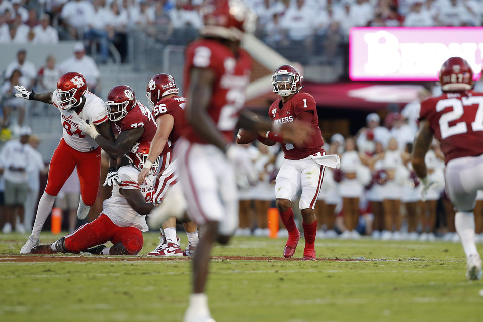 Photo - Oklahoma's Jalen Hurts (1) throws a touchdown pass to CeeDee Lamb (2)  during a college football game between the University of Oklahoma Sooners (OU) and the Houston Cougars at Gaylord Family-Oklahoma Memorial Stadium in Norman, Okla., Sunday, Sept. 1, 2019. Oklahoma won 49-31. [Bryan Terry/The Oklahoman]