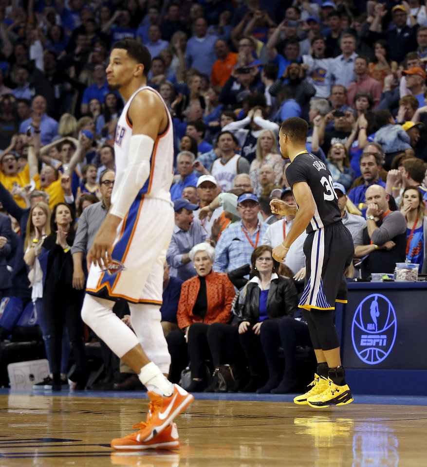 Photo - Golden State's Stephen Curry (30) heads back to the Warriors bench after hitting a 3-point shot against Oklahoma City's Andre Roberson (21), left, with 0.6 seconds left in overtime during an NBA basketball game between the Oklahoma City Thunder and the Golden State Warriors at Chesapeake Energy Arena in Oklahoma City, Saturday, Feb. 27, 2016. Golden State won 121-118 in overtime. Photo by Nate Billings, The Oklahoman