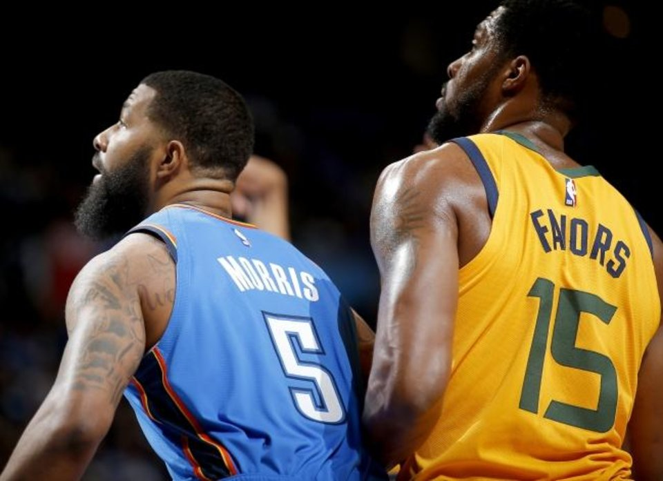 Photo -  Oklahoma City's Markieff Morris tries to box out Utah's Derrick Favors on a free-throw attempt during Friday's epic 148-147 Thunder victory in double overtime. Morris played 17 minutes that night in his OKC debut. [Sarah Phipps/The Oklahoman]