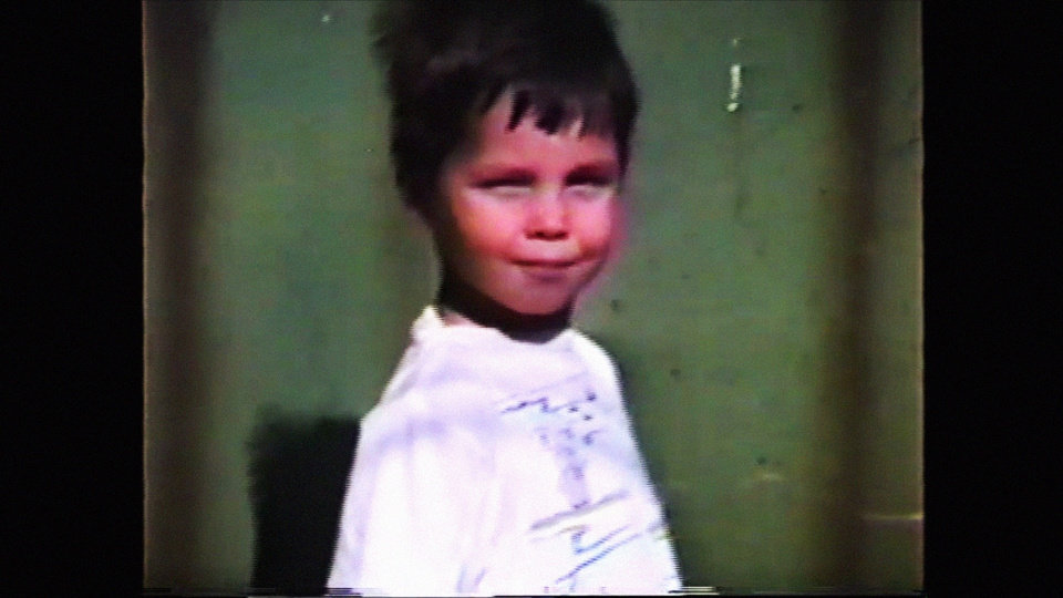 "Photo -  Oklahoma filmmaker Iancu ""Bunee"" Tomlinson is seen as a child in a still from his autobiographical short film"
