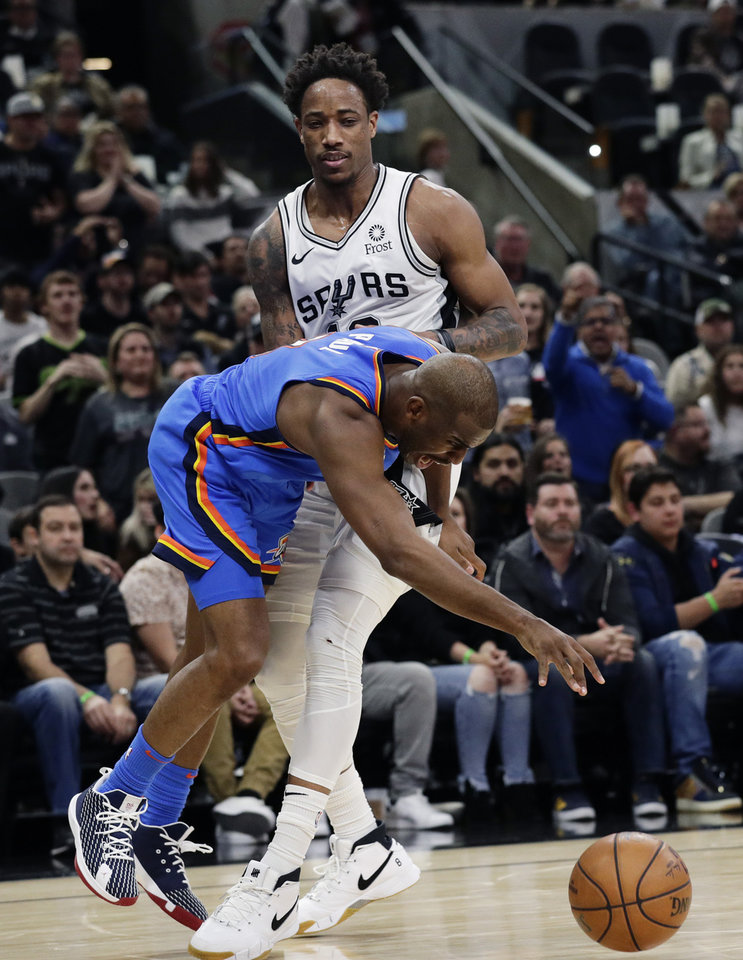 Photo - Oklahoma City Thunder guard Chris Paul (3) steals the ball from San Antonio Spurs guard DeMar DeRozan (10) during the second half of an NBA basketball game, in San Antonio, Thursday, Jan. 2, 2020. Oklahoma City won 109-103. (AP Photo/Eric Gay)