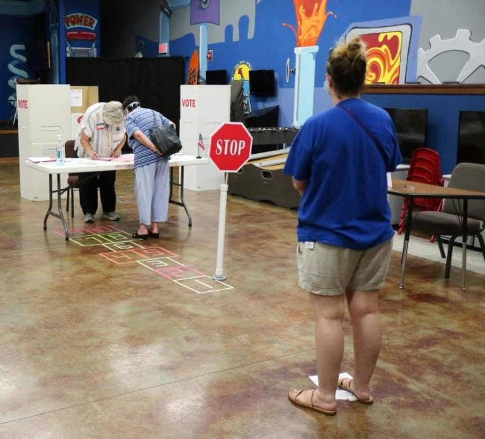 Photo -  Social distancing for voting at precinct 61 in Edmond, Tuesday, June 30, 2020. [Doug Hoke/The Oklahoman]