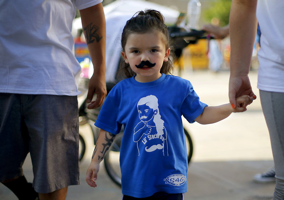 Photo - Dressed as Steven Adams, Thomas Kalinich, 3, of Oklahoma City waits outside Chesapeake Energy Arena before Game 6 of the Western Conference finals in the NBA playoffs between the Oklahoma City Thunder and the Golden State Warriors at Chesapeake Energy Arena in Oklahoma City, Saturday, May 28, 2016. Photo by Bryan Terry, The Oklahoman