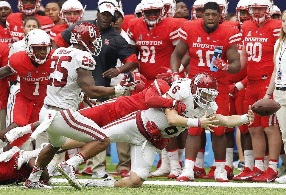 Photo - Oklahoma's Baker Mayfield loses the ball in the fourth quarter of the AdvoCare Texas Kickoff college football game between the University of Oklahoma Sooners (OU) and the Houston Cougars at NRG Stadium in Houston, Saturday, Sept. 3, 2016. Houston won 33-23. Photo by Bryan Terry, The Oklahoman