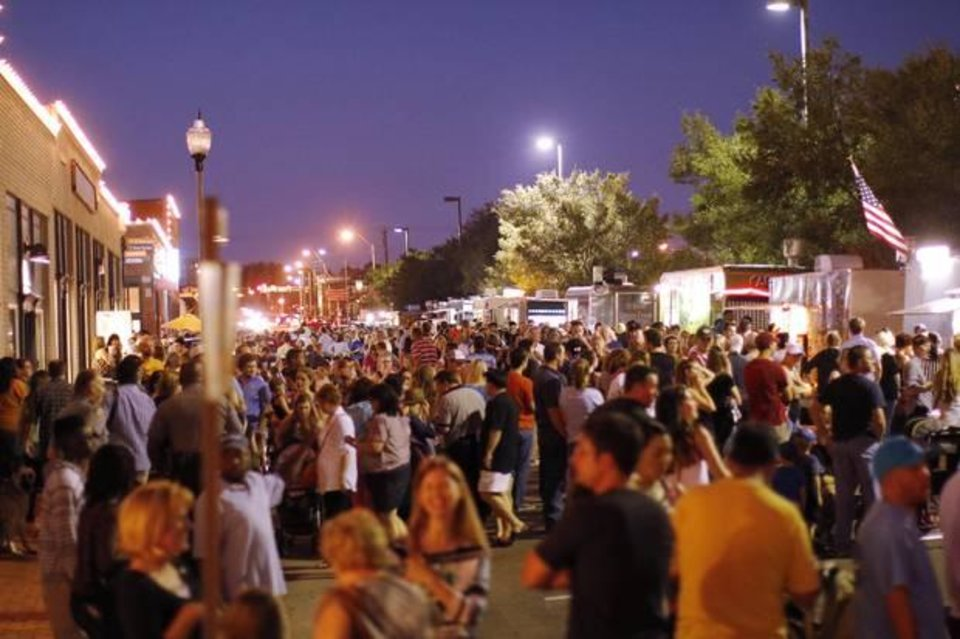 Photo - The crowd gathers during H&8th Night Market on Hudson between 7th and 8th streets, Friday, September 27, 2013. Photo by Doug Hoke, The Oklahoman Archive