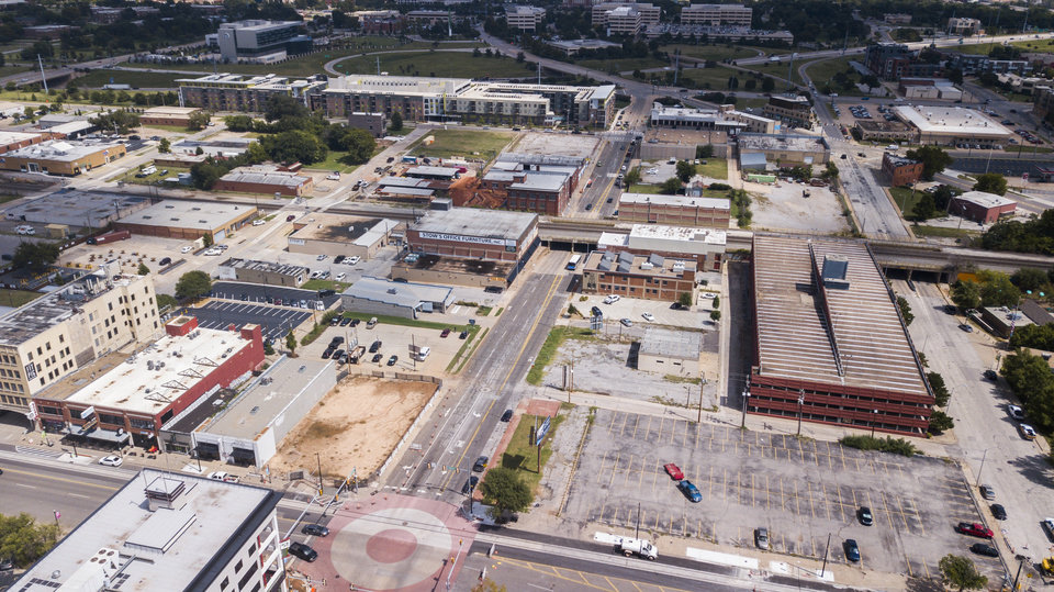 Photo -  Site work recently started for the future Heartland headquarters, which is being built on the parking lot shown facing Broadway in this photo. The proposed TownePlace Suites will be built to the north of the garage. [Photo by Dave Morris, The Oklahoman]