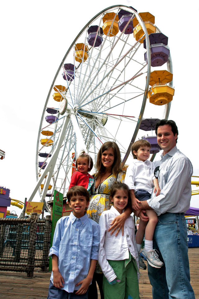 Photo - The Humphreys family right to left: Grant, Jack, Emma, Jenifer, Mary, and Ford from Oklahoma City pose in front of the Pacific Park Ferris Wheel on the Santa Monica Pier on Sunday, May 4, 2008 in Santa Monica, Calif. Grant Humphreys placed the winning bid on eBay $132,400 for the Pacific Wheel with plans to bring it home to Oklahoma City. [AP PHOTO/STEFANO PALTERA]