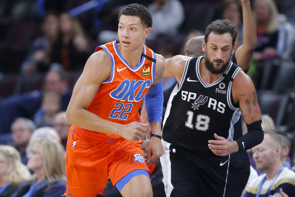 Photo - Oklahoma City's Isaiah Roby runs beside San Antonio's Marco Belinelli during an NBA basketball game between the Oklahoma City Thunder and the San Antonio Spurs at Chesapeake Energy Arena in Oklahoma City, Sunday, Feb. 23, 2020. [Bryan Terry/The Oklahoman]