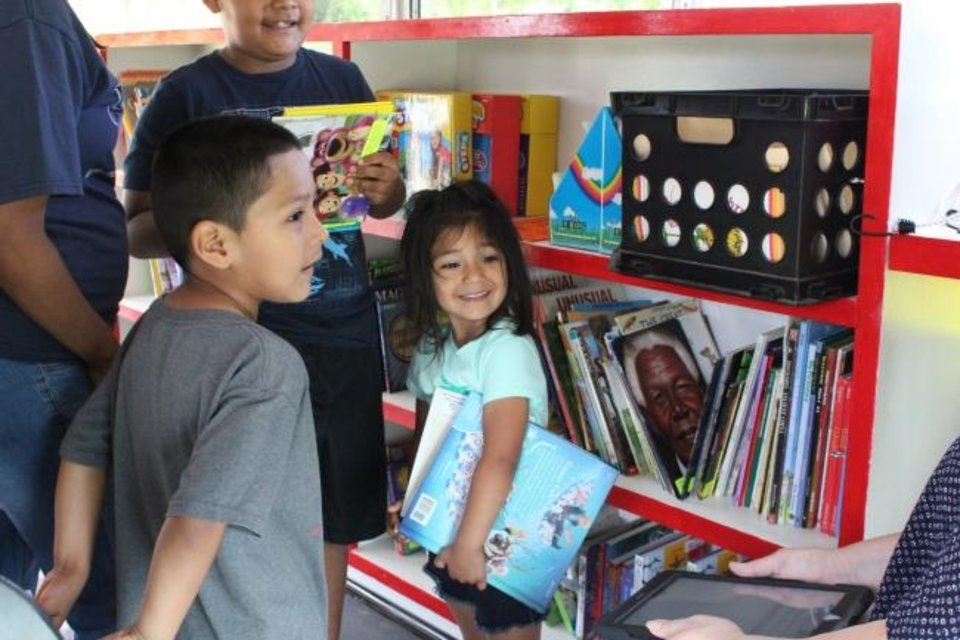 Photo -  The Bronco Bus is a mobile literacy station that will travel the Mustang school district throughout June and July, offering free books, fun games, guest readers and STEM activities to engage children of all ages. [PHOTO PROVIDED]