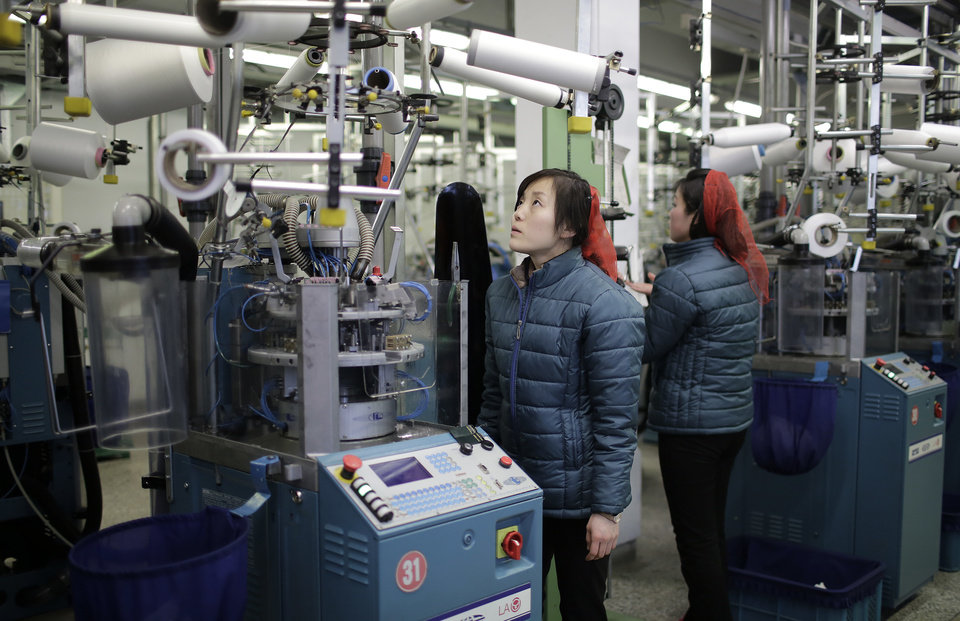 Photo - North Korean women mend stocking making machines at the Pyongyang Sock Factory on Monday, Jan. 9, 2017, in Pyongyang, North Korea. The country's leader, Kim Jong Un, made the call on New Year's day for the nation to keep building up its nuclear and long-range missile capacity, which have brought severe international sanctions, while at the same time expanding the economy to lift the nation's standard of living. (AP Photo/Wong Maye-E)