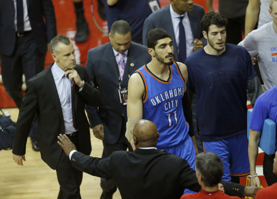 Photo - Oklahoma City's Enes Kanter (11) and Alex Abrines (8) walk off the court after Game 2 in the first round of the NBA playoffs between the Oklahoma City Thunder and the Houston Rockets in Houston, Texas,  Wednesday, April 19, 2017.  Photo by Sarah Phipps, The Oklahoman