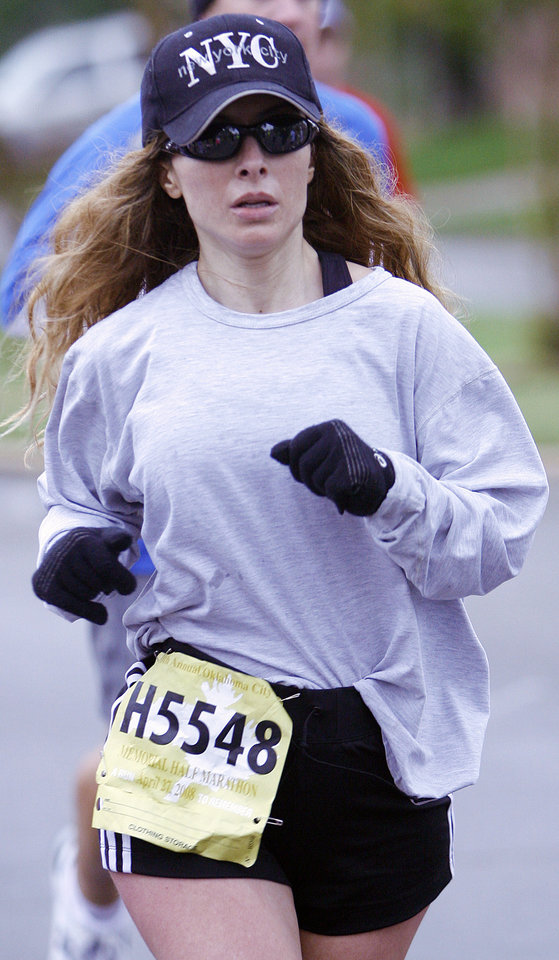 Photo - RUN, RUNNER, RUNNING: Jila Nelson, of Austin, TX., competes during the eighth annual Oklahoma City Memorial Marathon on Sunday , April 27, 2008, in Oklahoma City, Okla.   PHOTO BY CHRIS LANDSBERGER   ORG XMIT: KOD