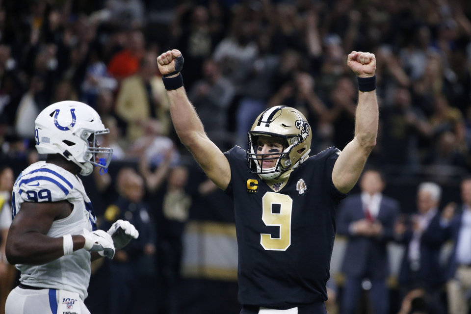 Photo - New Orleans Saints quarterback Drew Brees (9) celebrates his touchdown pass to tight end Josh Hill, which broke the NFL record for career touchdown passes, surpassing Peyton Manning, in the second half of an NFL football game against the Indianapolis Colts in New Orleans, Monday, Dec. 16, 2019. (AP Photo/Butch Dill)