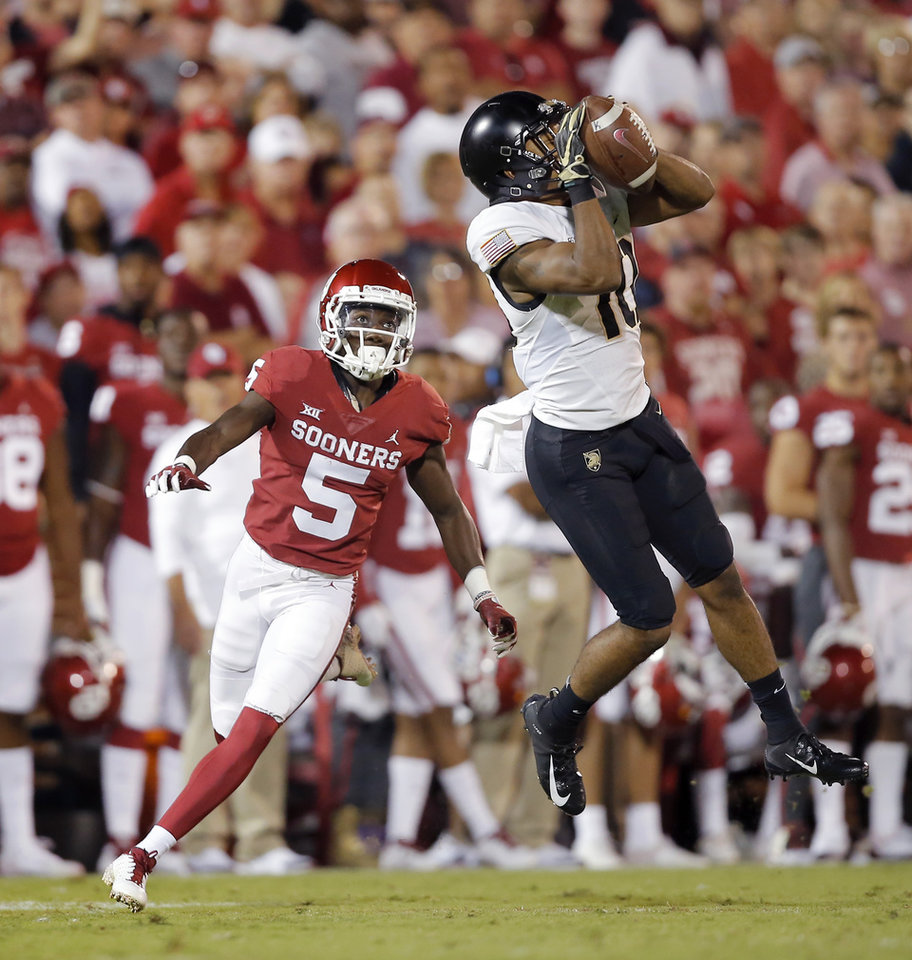 Photo - Army's Mike Reynolds (10) intercepts a pass intended for Oklahoma's Marquise Brown (5) during a college football game between the University of Oklahoma Sooners (OU) and the Army Black Knights at Gaylord Family-Oklahoma Memorial Stadium in Norman, Okla., Saturday, Sept. 22, 2018. Photo by Bryan Terry, The Oklahoman