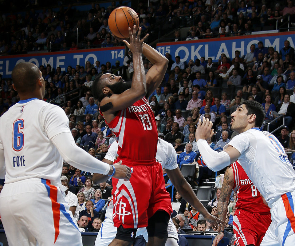 Photo - James Harden (13) shoots the ball beside Oklahoma City's Enes Kanter (11) during an NBA basketball game between the Oklahoma City Thunder and the Houston Rockets at Chesapeake Energy Arena in Oklahoma City, Tuesday, March 22, 2016. Oklahoma City won 111-107. Photo by Bryan Terry, The Oklahoman