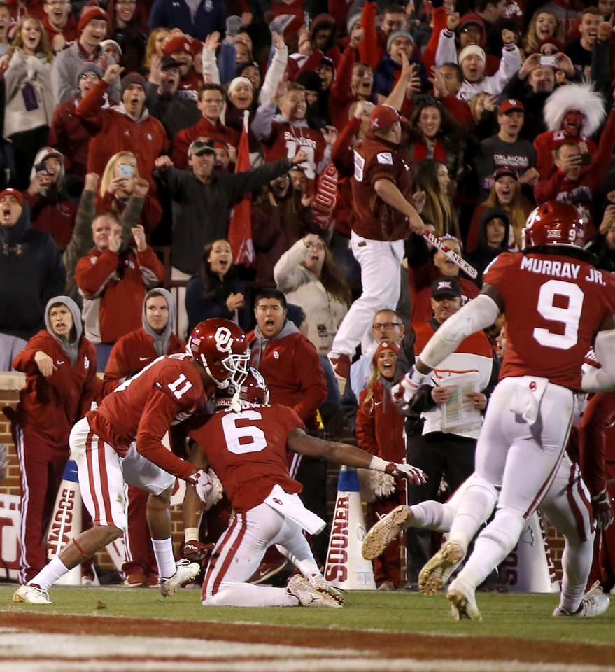 Photo - Oklahoma's Parnell Motley (11) and Tre Brown (6) celebrate after Oklahoma State failed to complete a pass for a two-point conversion during a Bedlam college football game between the University of Oklahoma Sooners (OU) and the Oklahoma State University Cowboys (OSU) at Gaylord Family-Oklahoma Memorial Stadium in Norman, Okla., Nov. 10, 2018.  Photo by Bryan Terry, The Oklahoman