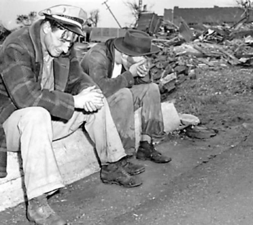 Photo - Brothers J.E., left, and Clifford Taylor mourn their brother, Lester, who was killed when a tornado hit Pryor April 27, 1942. (Photo originally taken 04/27/42, ran 04/28/42, Times)