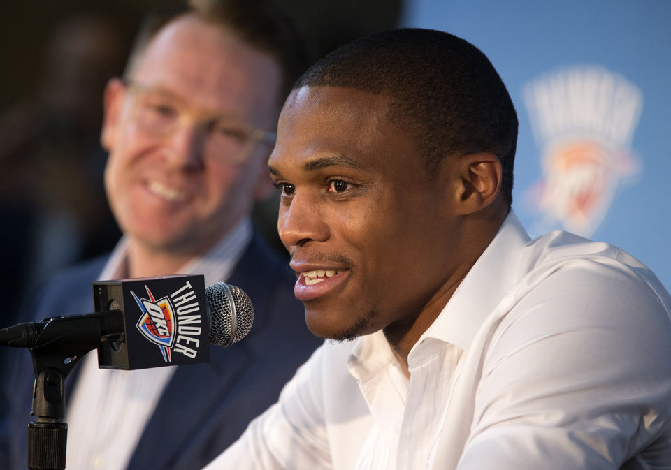 Photo - Oklahoma City Thunder general manager Sam Presti looks on as Russell Westbrook speak during a press conference to announce his three year contract extension with the team at the Chesapeake Energy Arena in Oklahoma City, Okla. on Thursday, Aug. 4, 2016. Photo by Chris Landsberger, The Oklahoman