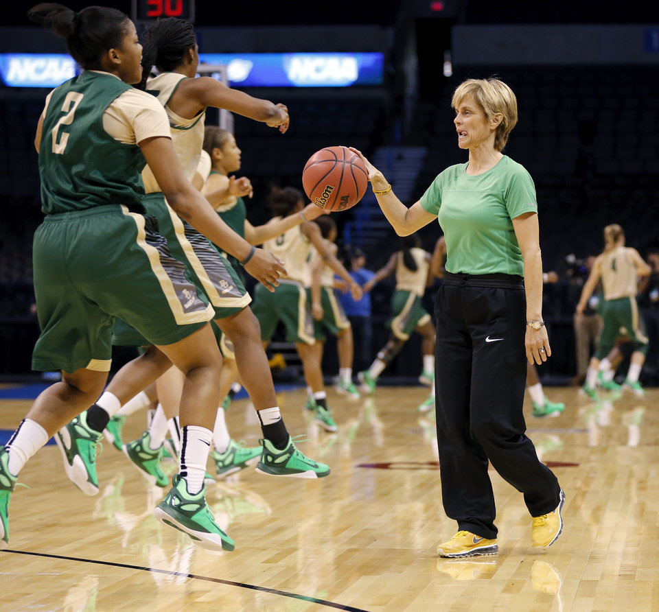 Photo - Baylor coach Kim Mulkey dribbles a basketball as her players warm up during the first practice day for the Oklahoma City Regional in the NCAA Division I Women's Basketball Championship at Chesapeake Energy Arena in Oklahoma City, Thursday, March 26, 2015. Photo by Nate Billings, The Oklahoman