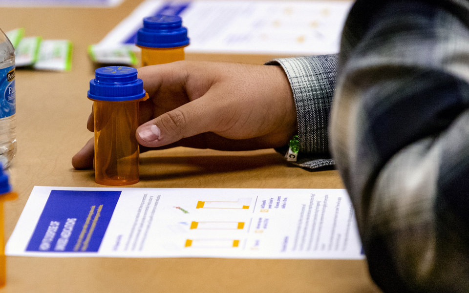 Photo - A student reads over the drug disposal worksheet during the launch of an interactive prescription drug safety course designed for high school students at Capitol Hill High School in Oklahoma City, Okla. on Friday, Jan. 31, 2020. The safety program is launched by Attorney General Mike Hunter, executives from Walmart, EVERFI, and Oklahoma City Public Schools. [Chris Landsberger/The Oklahoman]