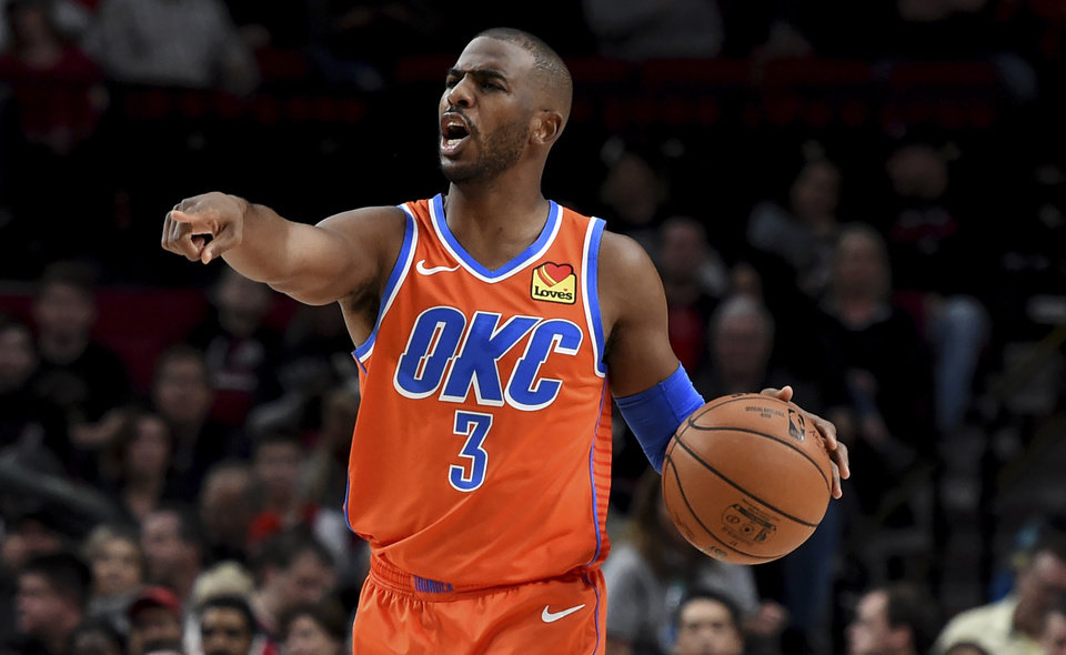Photo - Oklahoma City Thunder guard Chris Paul directs his teammates during the first half of an NBA basketball game against the Portland Trail Blazers in Portland, Ore., Sunday, Dec. 8, 2019. (AP Photo/Steve Dykes)