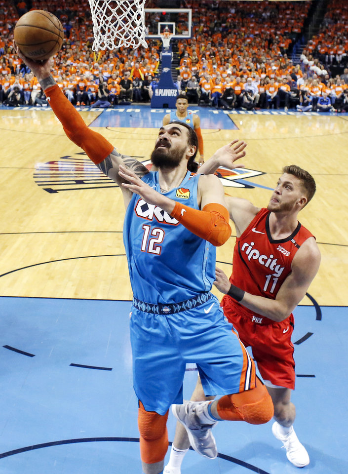 Photo - Oklahoma City's Steven Adams (12) scores in front of Portland's Meyers Leonard (11) in the first half during Game 3 in the first round of the NBA playoffs between the Portland Trail Blazers and the Oklahoma City Thunder at Chesapeake Energy Arena in Oklahoma City, Friday, April 19, 2019. Photo by Nate Billings, The Oklahoman