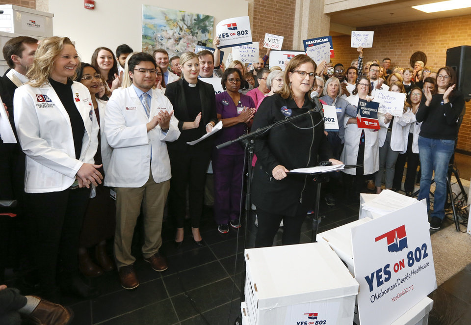 Photo - Amber England, Yes on 802 campaign manager, speaks in front of Medicaid expansion supporters before they delivered petitions to put state question 802 on the ballot to the Oklahoma Secretary of State's office in Oklahoma City, Thursday, Oct. 24, 2019. [Nate Billings/The Oklahoman]