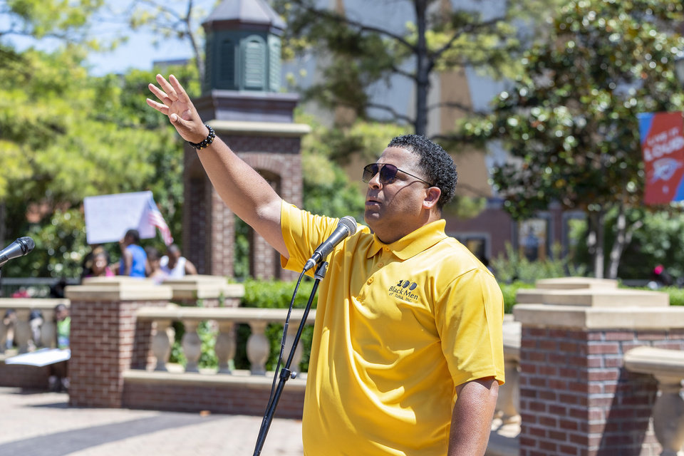 Photo - 100 Black Men of Tulsa President David Harris speaks during a Black Lives Matter OKC Rally in the Bricktown area of Oklahoma City on Saturday, June 6, 2020. Photo by Alonzo Adams for The Oklahoman.
