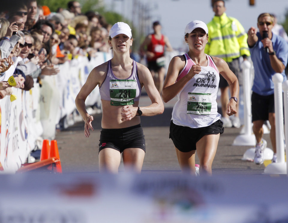 Photo - WOMAN / FEMALE: Catherine Lisle, right, passes Jenny Graef as they approach the finish line of the women's marathon during the 10th anniversary of the Oklahoma City Memorial Marathon Sunday, April 25, 2010 in Oklahoma City. Photo by Doug Hoke, The Oklahoman. ORG XMIT: KOD