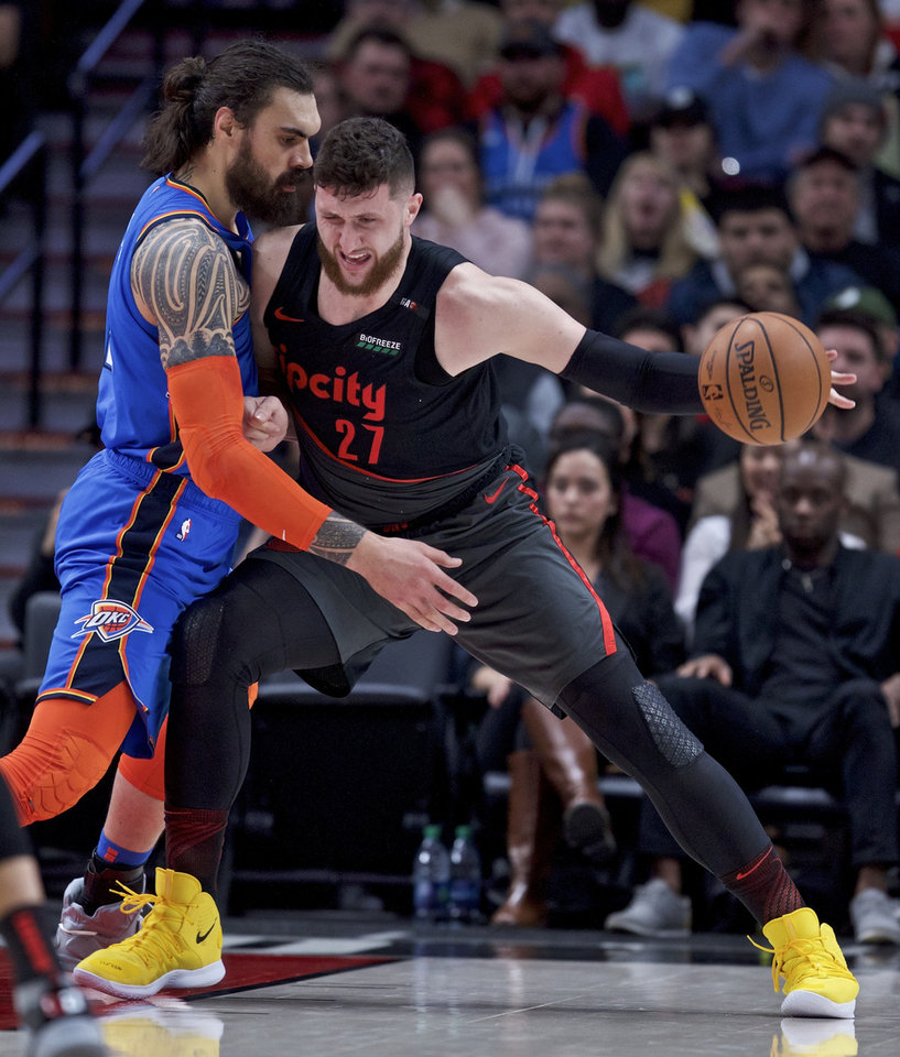 Photo - Portland Trail Blazers center Jusuf Nurkic, right, posts up against Oklahoma City Thunder center Steven Adams during the first half of an NBA basketball game in Portland, Ore., Thursday, March 7, 2019. (AP Photo/Craig Mitchelldyer)