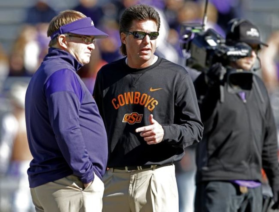 Photo -  OSU head coach Mike Gundy, right, and TCU head coach Gary Patterson talk before a game. [OKLAHOMAN ARCHIVES]