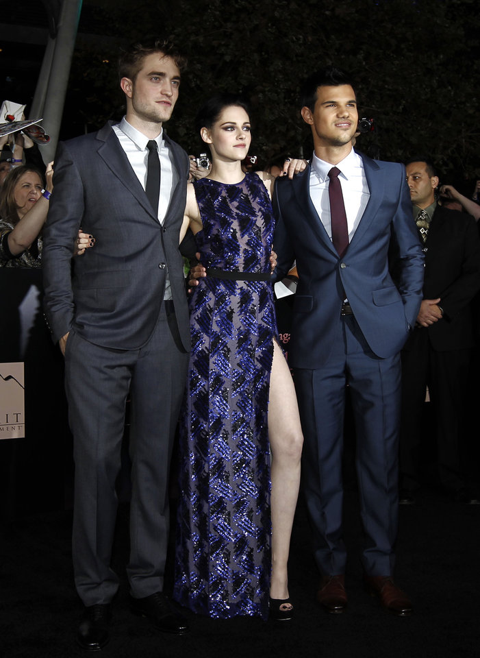 Photo - Actors Robert Pattinson, left, Kristen Stewart and Taylor Lautner, Right, arrive at the world premiere of