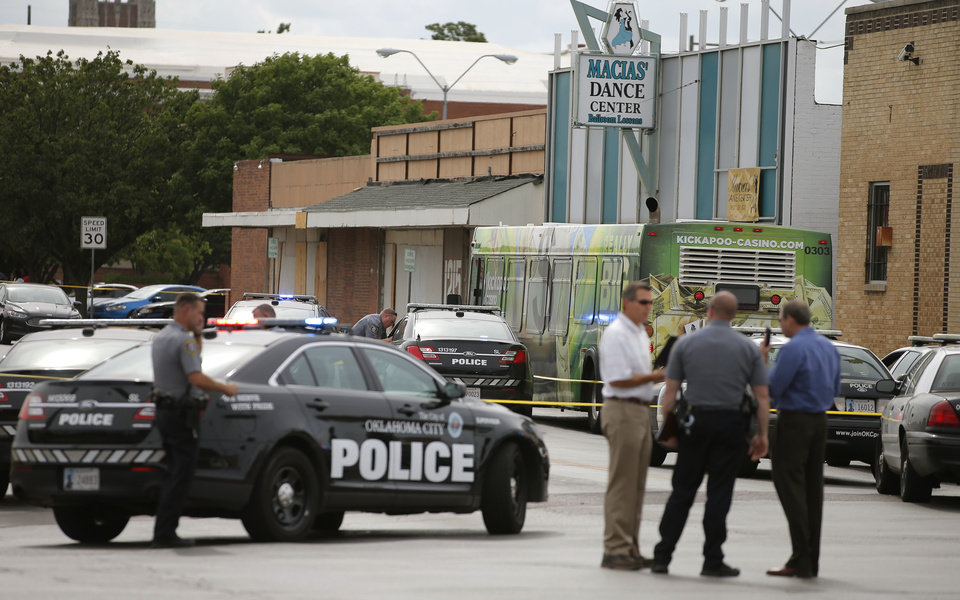 Photo - Oklahoma City Police surround a bus after a suspect was shot and killed by police near NW 23 and Classen in Oklahoma City, Friday, June 24, 2016. Photo by Bryan Terry, The Oklahoman