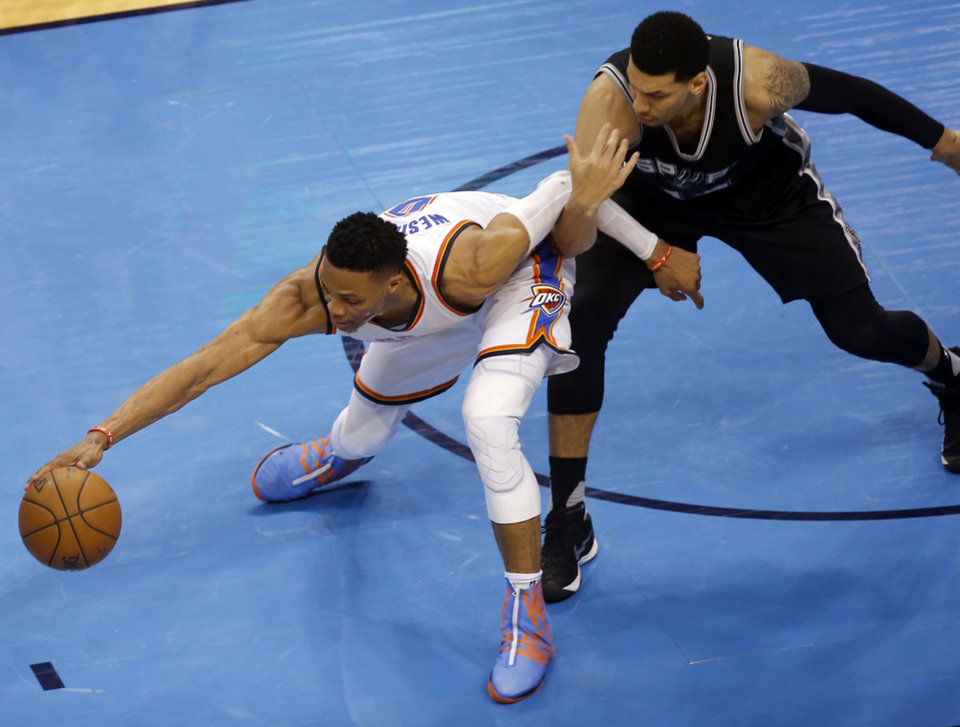 Photo - Oklahoma City's Russell Westbrook (0) grabs a loose ball as San Antonio's Danny Green (14) defends during Game 4 of the Western Conference semifinals between the Oklahoma City Thunder and the San Antonio Spurs in the NBA playoffs at Chesapeake Energy Arena in Oklahoma City, Sunday, May 8, 2016. Photo by Sarah Phipps, The Oklahoman