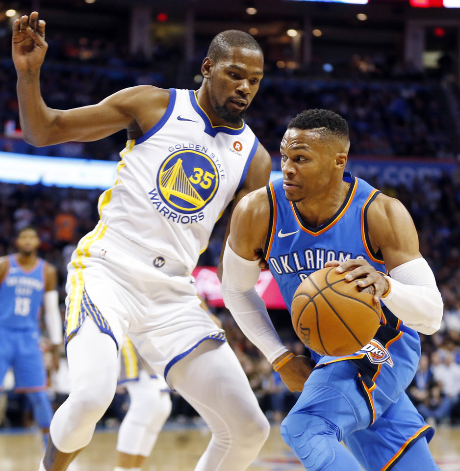 2be4ea5e9711 Oklahoma City s Russell Westbrook (0) works against Golden State s Kevin  Durant (35) during an NBA basketball game between the Oklahoma City Thunder  and the ...