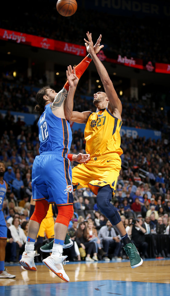 Photo - Oklahoma City's Steven Adams (12) defends against Utah's Rudy Gobert (27) during the NBA game between the Oklahoma City Thunder and the Utah Jazz at the Chesapeake Energy Arena, Friday, Feb. 22, 2019. Photo by Sarah Phipps, The Oklahoman
