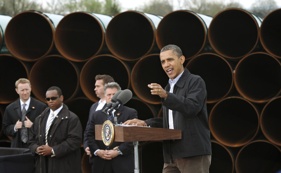 Photo - With  large oil pipe stacked 20 feet high as a backdrop, President Barack Obama delivered a speech promoting his administration's energy policies  to a group of about 200 invited guests at a pipe storage  yard just north of Ripley Thursday morning,  March 22, 2012.   Photo by Jim Beckel, The Oklahoman