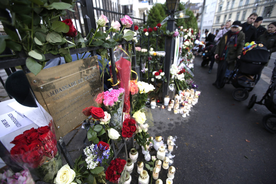 Photo - People stand in line to lay flowers in front of the French embassy in Oslo, Norway, Saturday Nov. 14, 2015, for the victims killed in Friday's attacks in Paris. French President Francois Hollande said more than 120 people died Friday night in shootings at Paris cafes, suicide bombings near France's national stadium and a hostage-taking slaughter inside a concert hall. (Vidar Ruud/NTB Scanpix via AP) NORWAY OUT