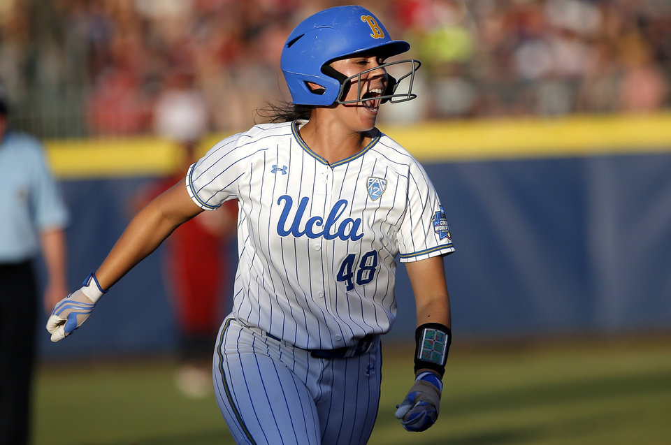 Photo - UCLA's Bubba Nickles (48) celebrates a home run in the 1st inning during the second NCAA softball game in the championship series of the Women's College World Series between Oklahoma and UCLA at USA Softball Hall of Fame Stadium in Oklahoma City, Tuesday, June 4, 2019. [Sarah Phipps/The Oklahoman]