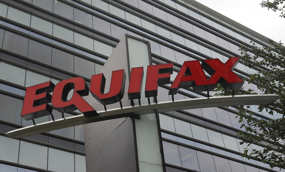Photo -  FILE - This July 21, 2012, file photo shows signage at the corporate headquarters of Equifax Inc. in Atlanta. The deadline to seek cash payments and claim free services as part of Equifax's $700 million settlement over a massive data breach is Wednesday, Jan. 22, 2020. (AP Photo/Mike Stewart, File)