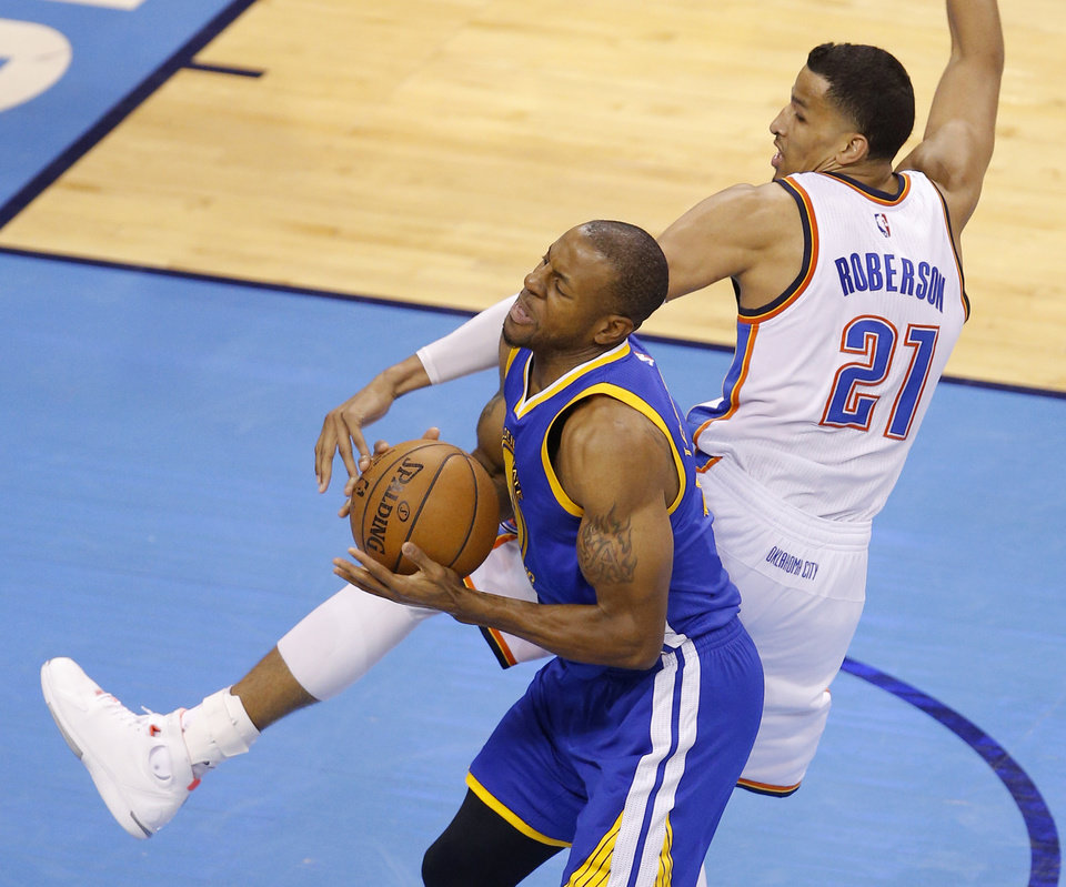 Photo - Oklahoma City's Andre Roberson (21) fouls Golden State's Andre Iguodala (9) during Game 6 of the Western Conference finals in the NBA playoffs between the Oklahoma City Thunder and the Golden State Warriors at Chesapeake Energy Arena in Oklahoma City, Saturday, May 28, 2016. Photo by Bryan Terry, The Oklahoman